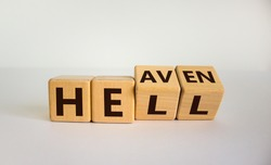 Hell or heaven. Turned cubes and changed the word 'hell' to 'heaven'. Concept. Beautiful white background, copy space.