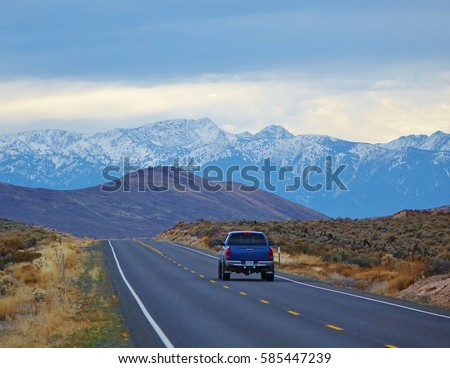 Hell's Canyon Scenic Byway. One car in the distance that's leaving Baker City, Oregon heading into the beautiful Wallowa Mountains on cold November day on State Route 86.