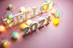 Hello 2021 alphabet letter with cotton ball LED decoration on pink background