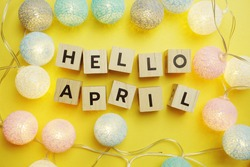 Hello April alphabet letter with LED Cotton ball Decoration on yellow background