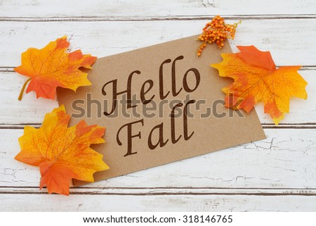 Hello Fall Card, A brown card with words Hello Fall over a distressed wood background with Autumn Leaves