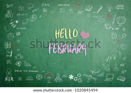Hello February greeting on green school teacher's chalkboard with creative student's doodle of learning education graphic freehand illustration icon for back to school month concept
