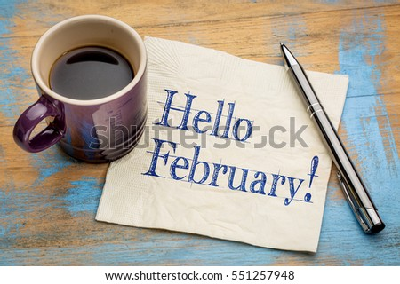Hello February - handwriting on a napkin with a cup of coffee