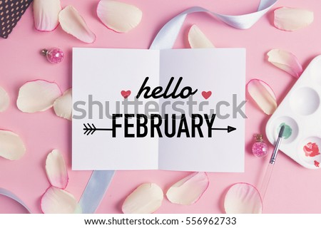 Photo of  Hello february on pastel background.