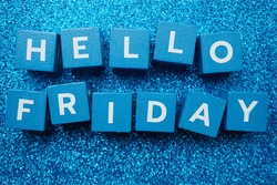 Hello Friday alphabet letter on  blue glitter background