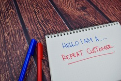Hello I am A Repeat Customer write on a book Isolated on wooden table background