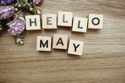 Hello May alphabet letters on wooden background