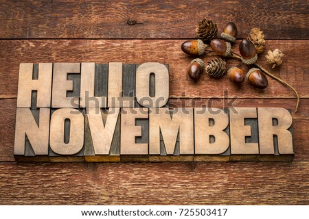 hello November greeting card - letterpress wood type blocks against grained wood with acorn decoration