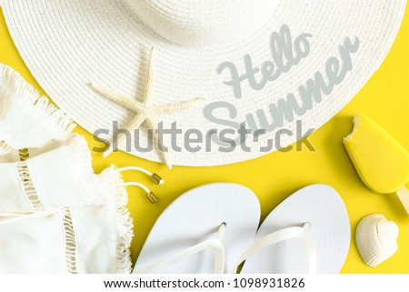 Hello summer text on sun hat, flip flops, ice cream and shells. Summertime, vacation, travel, tourism, seasonal concept. Yellow and white colors. Top view.  #1098931826