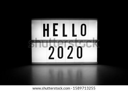 Hello 2020 - text on a display lightbox in the dark