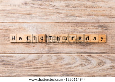 hello thursday word written on wood block. hello thursday text on wooden table for your desing, concept.