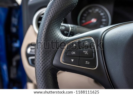 Helm of car, by closeup. Car wheel close up. Steering Wheel #1188111625