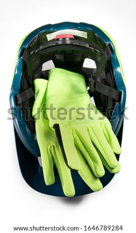 Helmet and fluorescent cycling gloves prepared for sale.