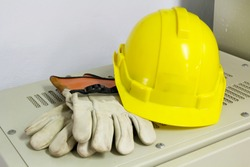 helmet and gloves for electrical work in the factory.