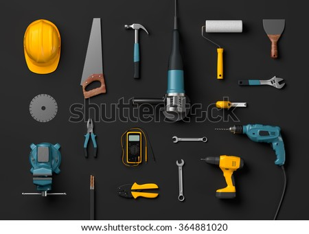 helmet, drill, angle grinder and construction tools on a black isolated background