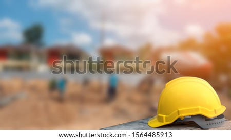helmet in construction site and construction site worker background