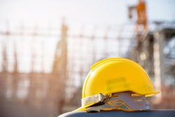 helmet in construction site and construction site worker background  safety first concept
