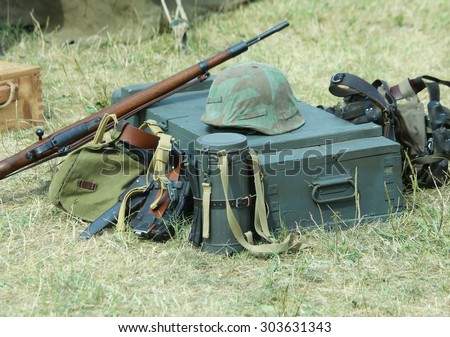 helmet of soldier uniform with a rifle in the army camp during a war exercise