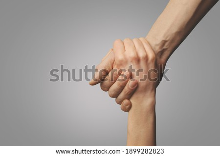 help friend through a tough time. rescue gesture. support, friendship and salvation concept. holding hands