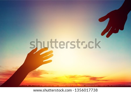Help hand on sunset background