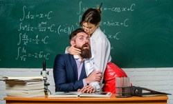 Help me. Authority abuse. Sexy woman dominating bearded man. Authority in relationship. Leadership and authority. Sensual student seduce teacher at lesson. Authority. Girls power.
