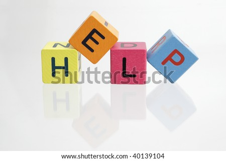 Help spell out in block letters isolated on white background - stock photo