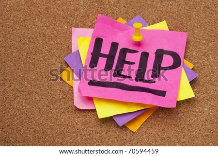 help - word handwritten on a stack of sticky notes posted on cork bulletin board