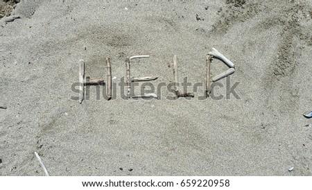 help written in sand #659220958