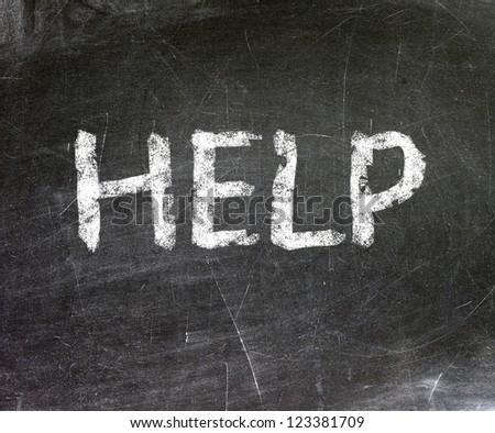 Help written on a blackboard.