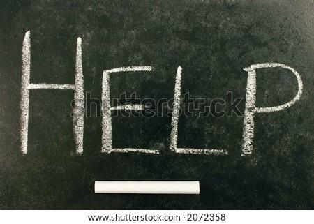 HELP, written on a blackboard - stock photo