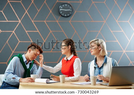 Helpful colleagues supporting and comforting their associate by workplace #730043269