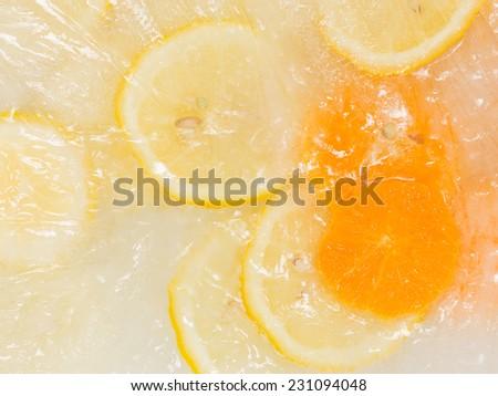 Helpful sweet delicious fresh fruit ice cream with slices of lemon and orange #231094048