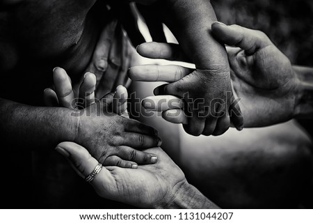 Helping children. Volunteer. Adult holding smal hands of little african child. Support and help to coutries of third world. Unity in diversity. Children suffer of poverty due to bad economy