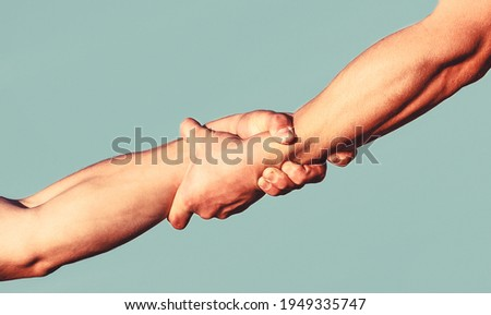 Helping hand concept and international day of peace, support. Helping hand outstretched, isolated arm, salvation. Close up help hand. Two hands, helping arm of a friend, teamwork. Stock photo ©