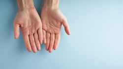 Helping hand, open palm, support in difficult situation, crisis. Last chance, hope concept. Two palms on blue background. Psychological service. Long banner