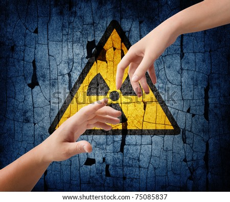 helping hands on an radiation sign