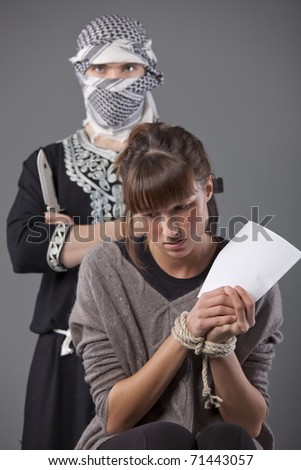 helpless and tied up female hostage and terrorist with knife