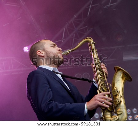 HELSINKI,FINLAND-AUGUST 14:Finnish saxophonist Timo Lassy and his extended orchestra and American star vocalist Jose James live on stage at Flow 2010 Festival on August 14, 2010 in Helsinki, Finland