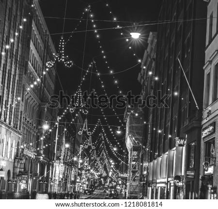 HELSINKI, FINLAND - 01.11.2018: Christmas decoration in Helsinki city. Helsinki tram on Christmas street.  #1218081814
