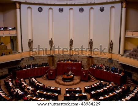 HELSINKI, FINLAND - MARCH 18: Plenary session at Plenary Room of Finnish Parliament, ministers on the right hand side on March 18, 2010 in Helsinki, Finland.