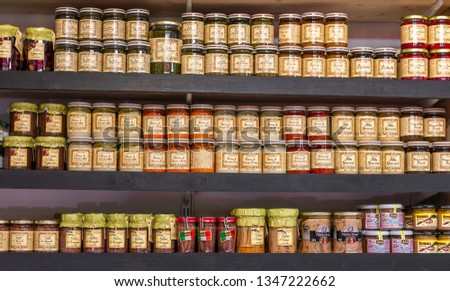 Helsinki, Finland - March 19, 2019: Various small glass jars with food items in the Market Hall #1347222662