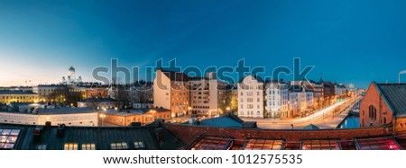 Helsinki, Finland. Panoramic View Of Helsinki Cathedral, Pohjoisranta Street And Redone Old Building For Banquet Hall In Evening Illuminations.