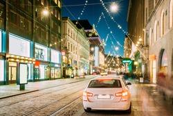 Helsinki, Finland.  Taxi Car Parking On Aleksanterinkatu Street. Xmas Christmas Lights Decorations And Festive Illumination. Winter Christmas Xmas Holiday Season.