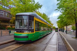 Helsinki. Finland. Tram on the city streets. Modern tram on the street of Helsinki. Public transport in Finland. Suomi. Tourism in Finland. Traveling in the European Union. Low floor trams.