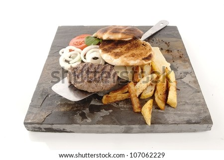 Helthy hamburger with chips and salad against grey
