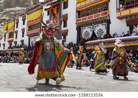 Hemis, Ladakh, India - June 27 2015 : Tibetan buddhist lamas (monks) dressed in mystical masks dance at  Hemis Tse Chu festival, Ladakh, North India #1188113536