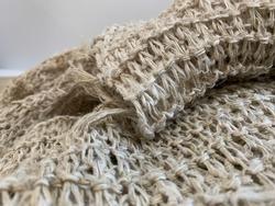 Hemp fibers woven into a piece, lightbrown natural fiber bundle texture and background