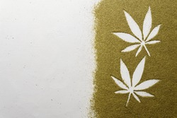 Hemp flour concept, top view. Scattered hemp flour on a light concrete surface. The image contains copy space, the shape of hemp leaves made of flour, horizontal orientation.