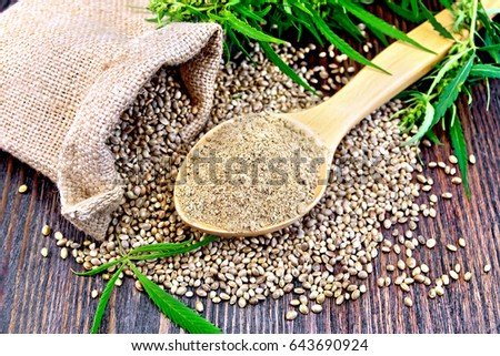 Shutterstock Hemp flour in a spoon, the grain in the bag and on the table,  leaves and stalks of cannabis on the background of wood planks