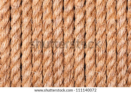 Hemp rope in a symmetrical side by side pattern for use as a background in any design.